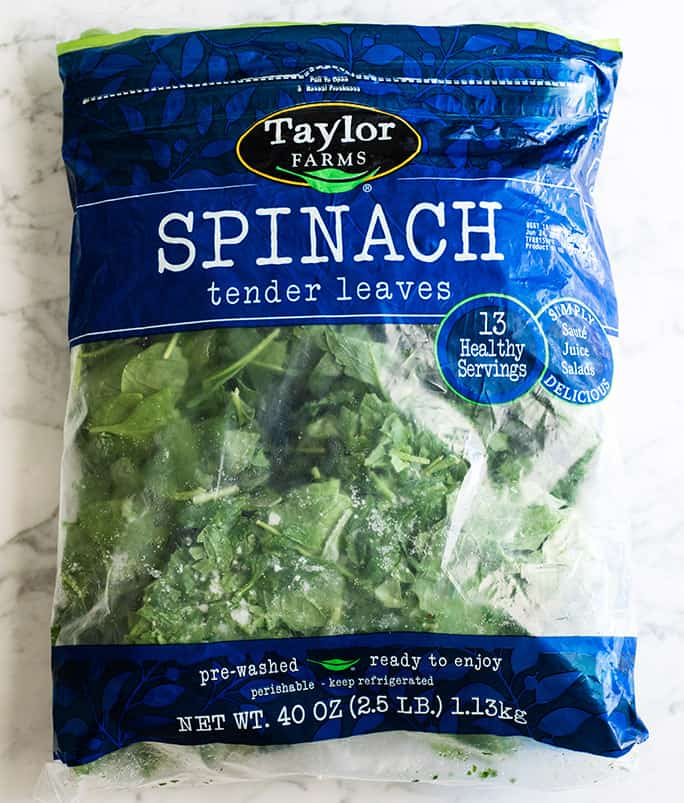 overhead view of a large (2.5 LB) bag of frozen spinach