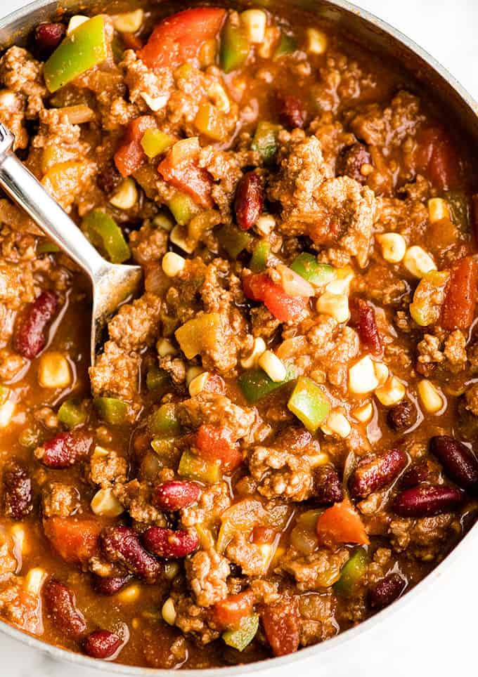 overhead view of a pan of Easy Chili Recipe with a spoon taking a scoop