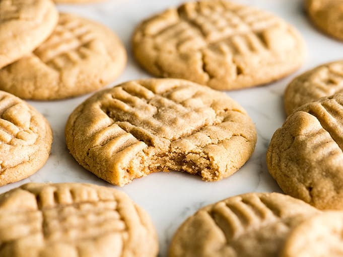 front view of a peanut butter cookie with a bite taken out of it