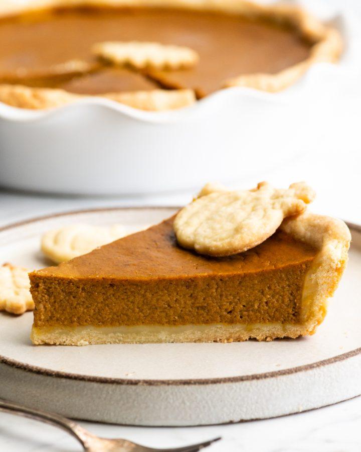 A slice of Pumpkin Pie on a plate