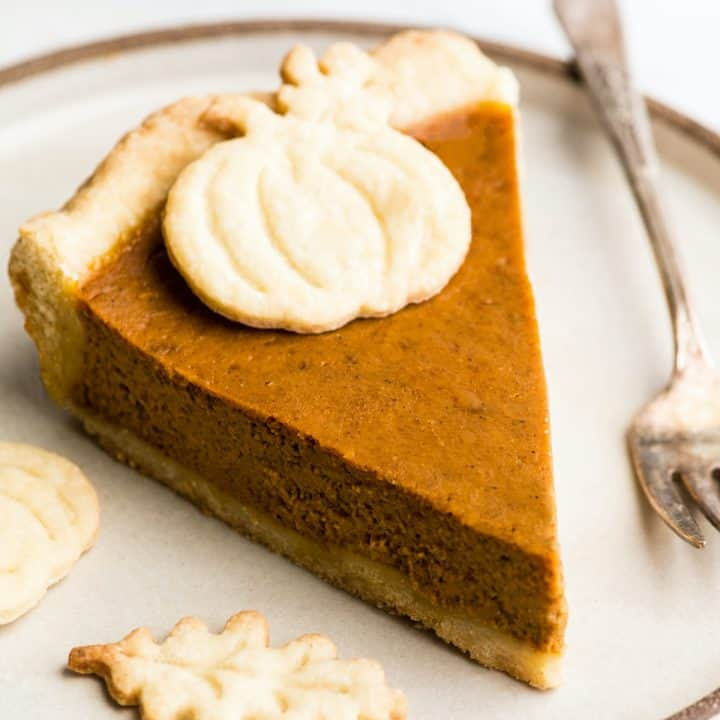 Front/overhead view of a slice of the best pumpkin pie on a plate