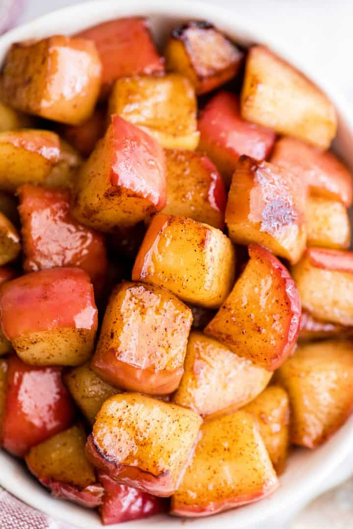 up close overhead view of cinnamon apples in a bowl