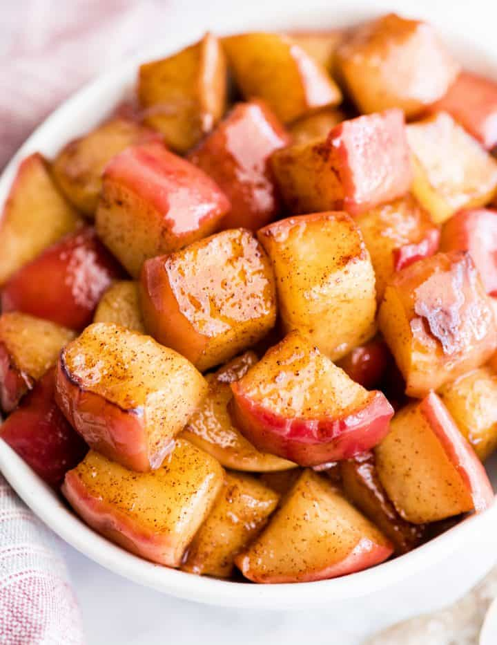 up close front view of cinnamon apples in a bowl