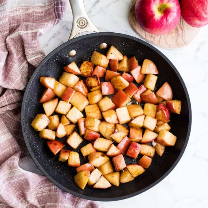 Overhead view of sautéed cinnamon apples in a non-stick fry pan