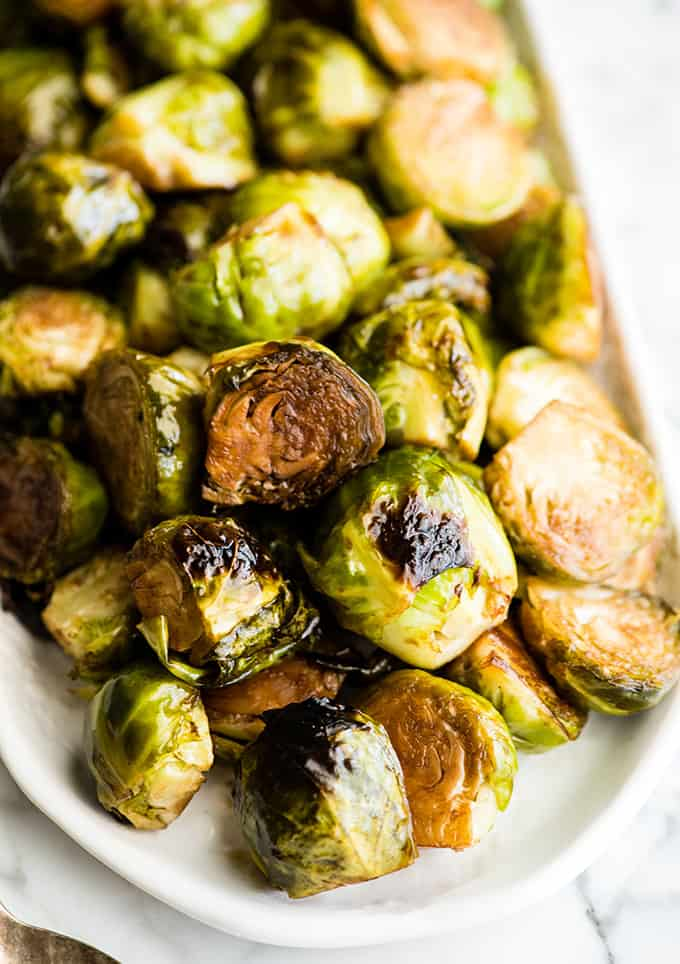 Overhead view of a serving dish with balsamic roasted brussel sprouts