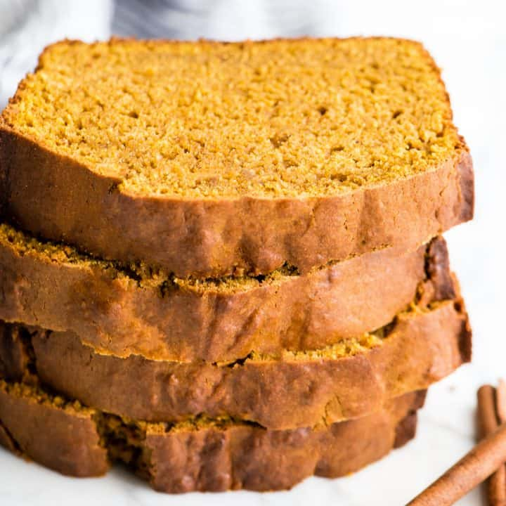 stack of four pieces of pumpkin bread