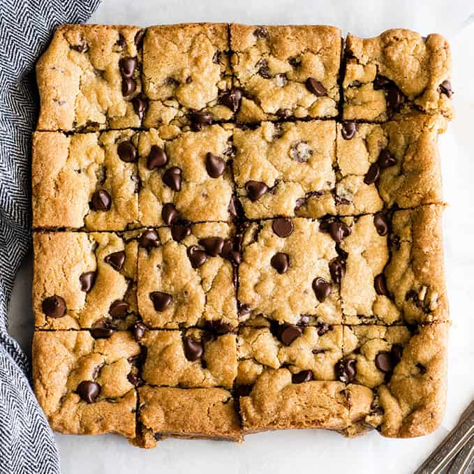 overhead view of 16 chocolate chip cookie bars cut into squares