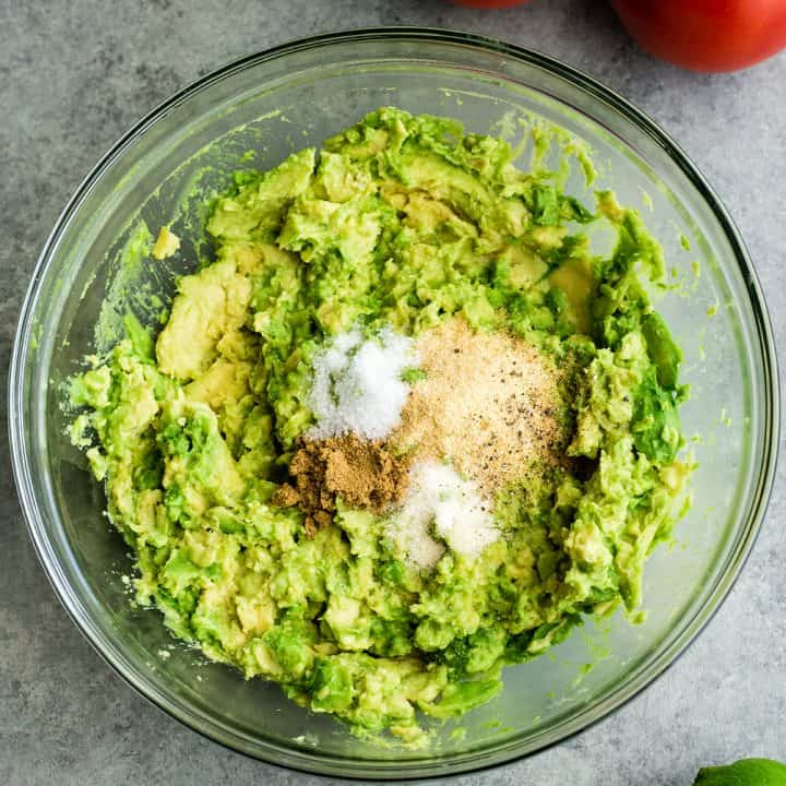 photo showing How to make Guacamole - adding spices and salt