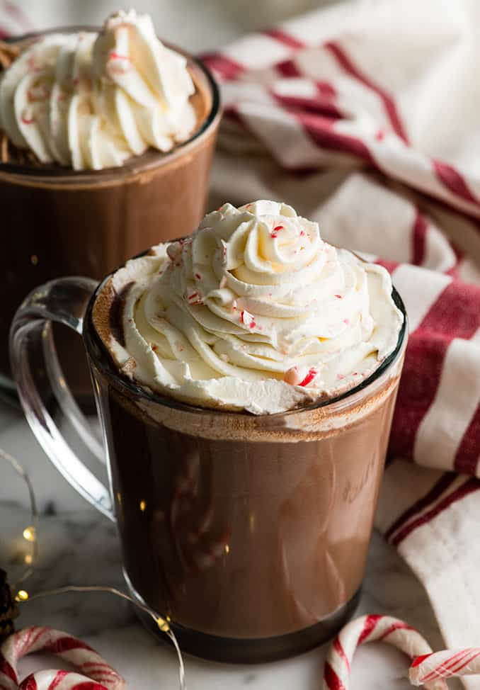 two mugs of peppermint hot chocolate with whipped cream