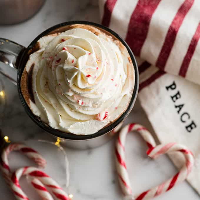 overhead view of peppermint hot chocolate with whipped cream