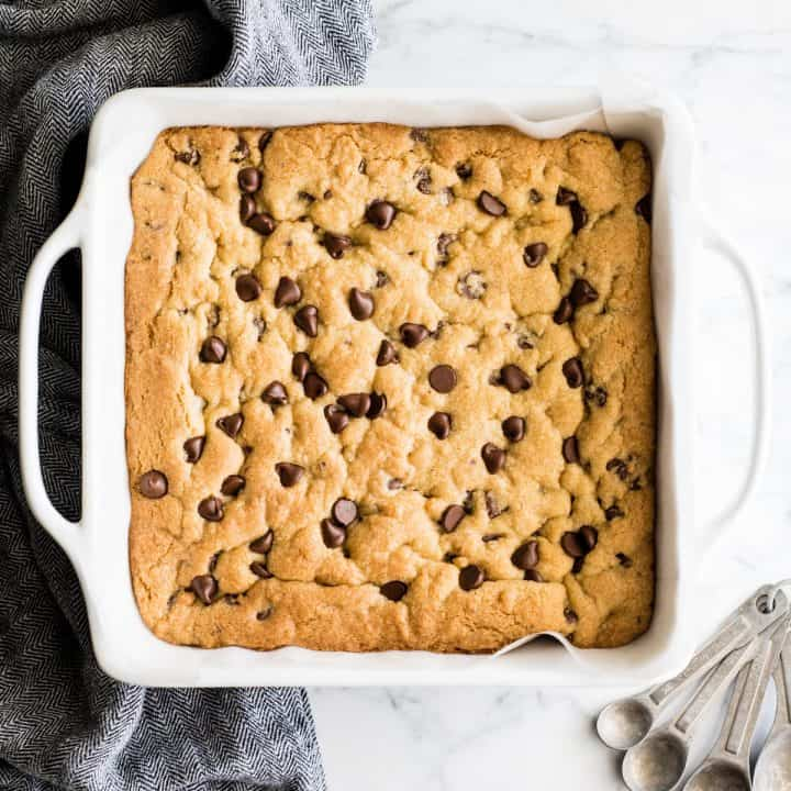 overhead view of chocolate chip cookie bars baked in a square dish