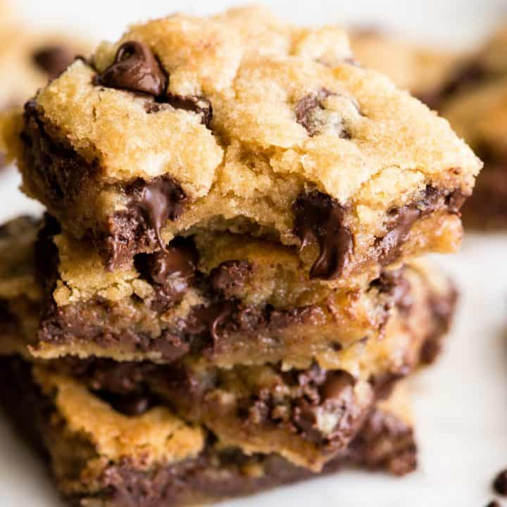 front view of a stack of 4 chocolate chip cookie bars.