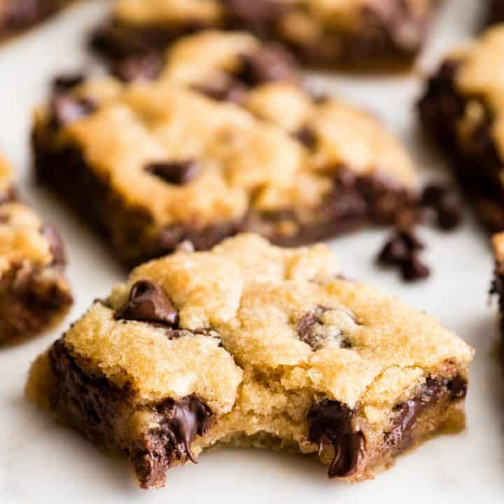 front view of a chocolate chip cookie bar with a bite taken out of it