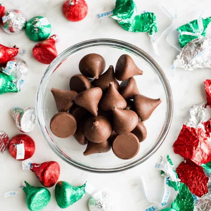 overhead view of a bowl of unwrapped chocolate kisses