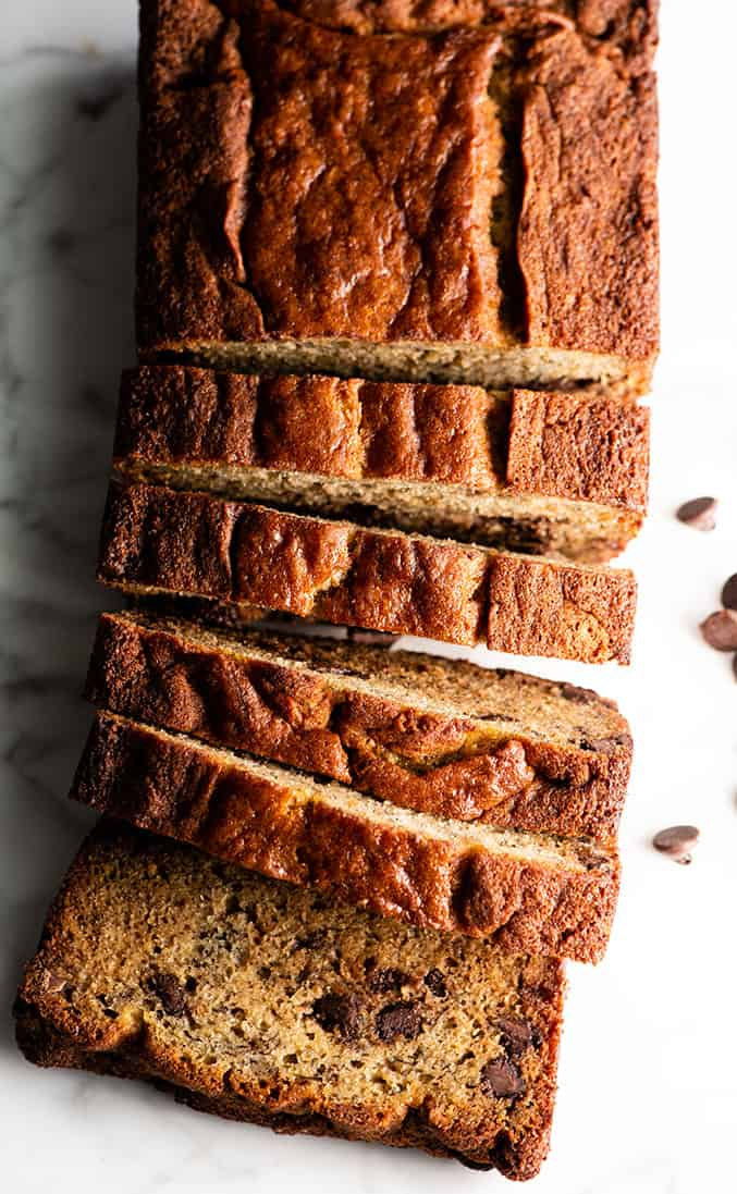 overhead view of a loaf of chocolate chip banana bread with 5 slices cut