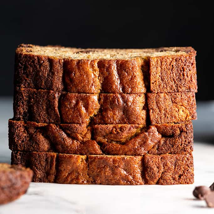 front view of a stack fo 4 pieces of chocolate chip banana bread