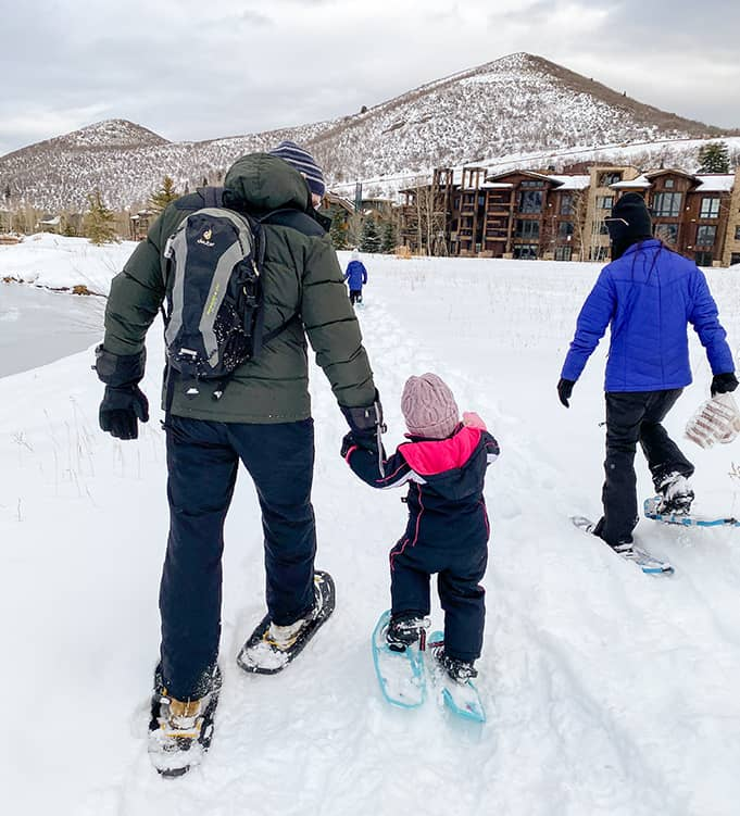 father and daughter snowshoeing at Deer valley Resort