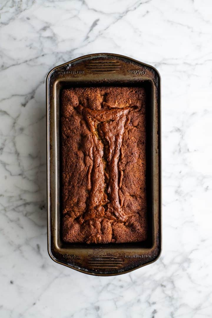 overhead view of a baked loaf of chocolate chip banana bread in a loaf pan