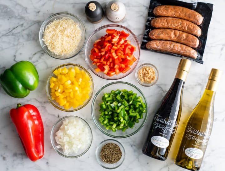 overhead view of the ingredients in this chicken sausage and peppers recipe