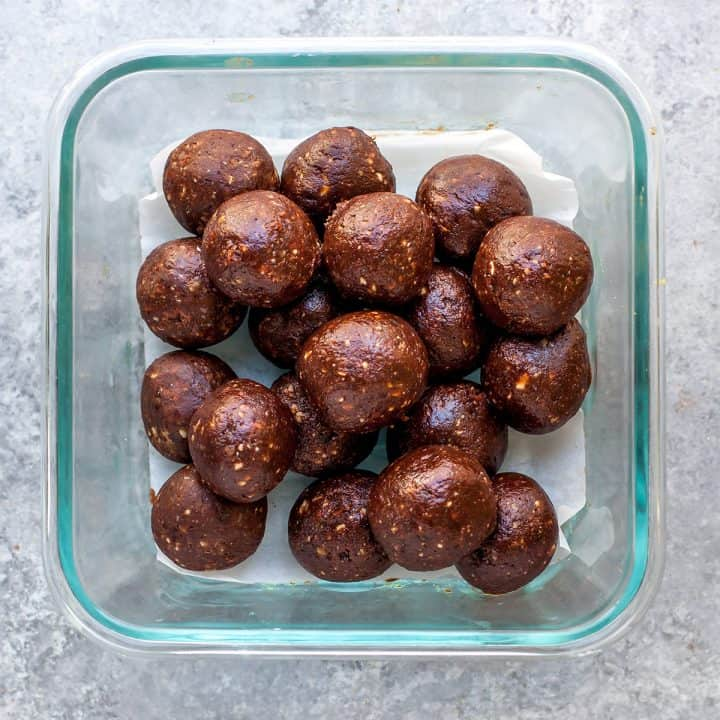 overhead view of date energy balls in a glass container