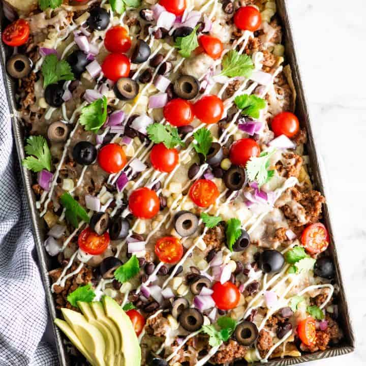 overhead photo of the best nachos recipe with nacho toppings