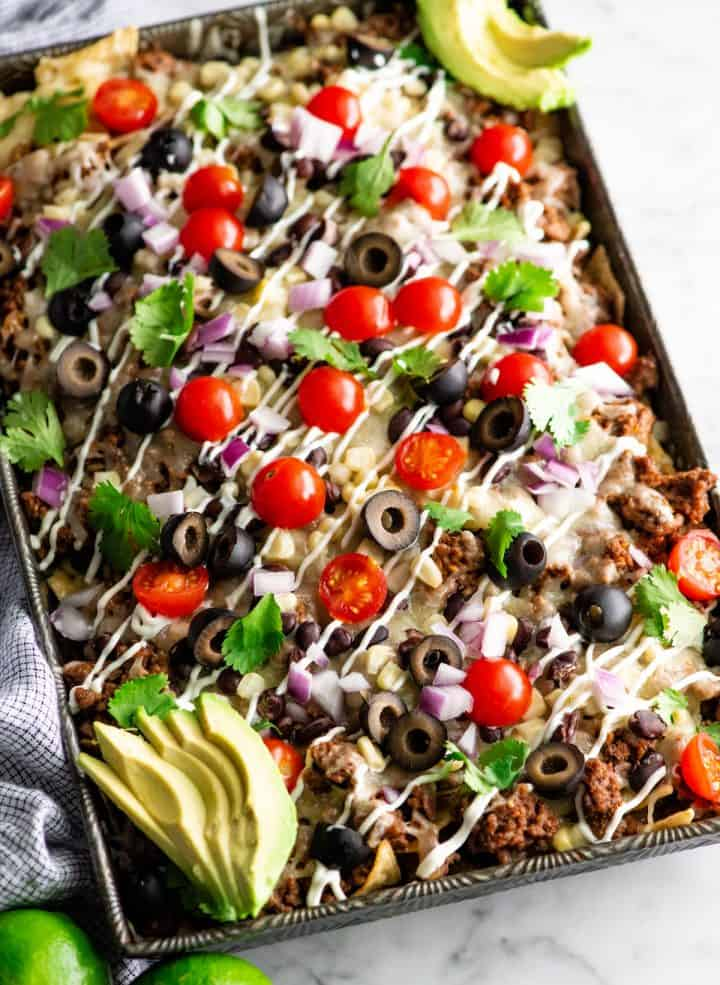 up close overhead view of nachos recipe with nacho toppings