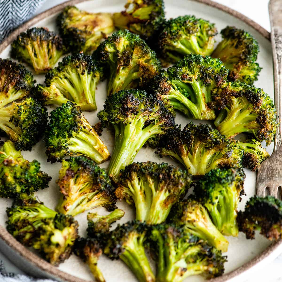 overhead view of oven roasted broccoli on a plate