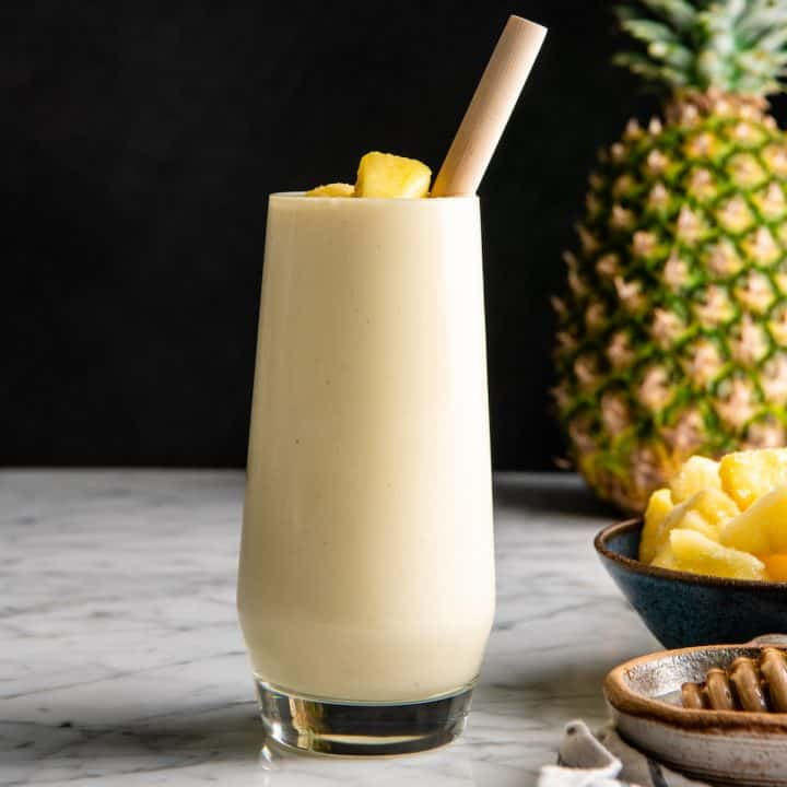 front view of a pineapple smoothie in a glass