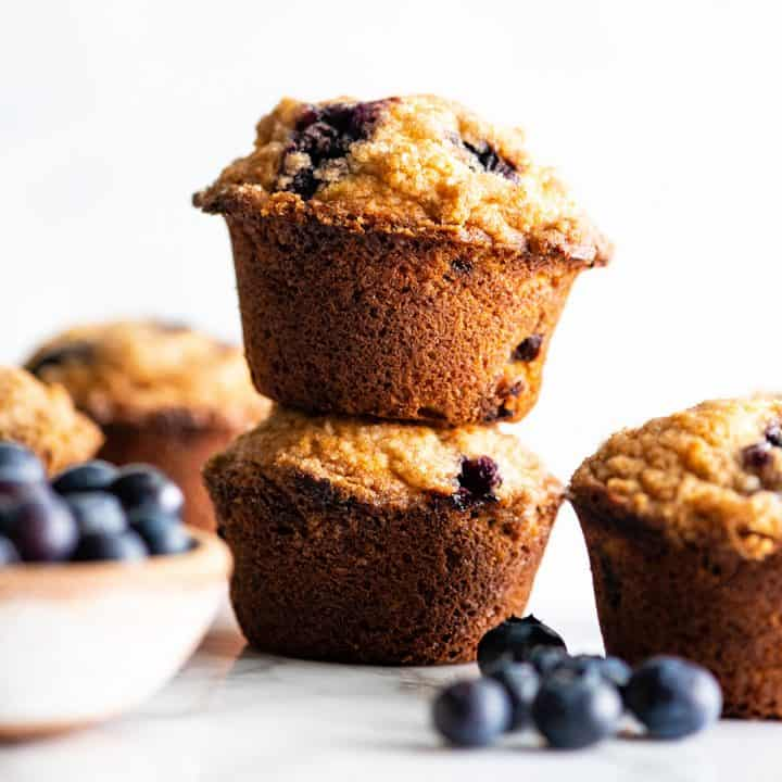 front view of two blueberry muffins stacked on each other