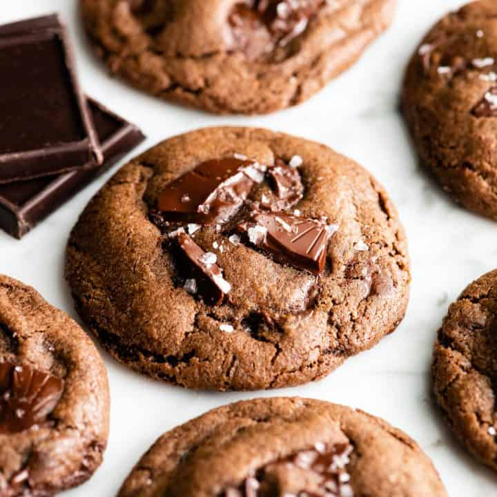 front view of 6 chocolate cookies with sea salt on top