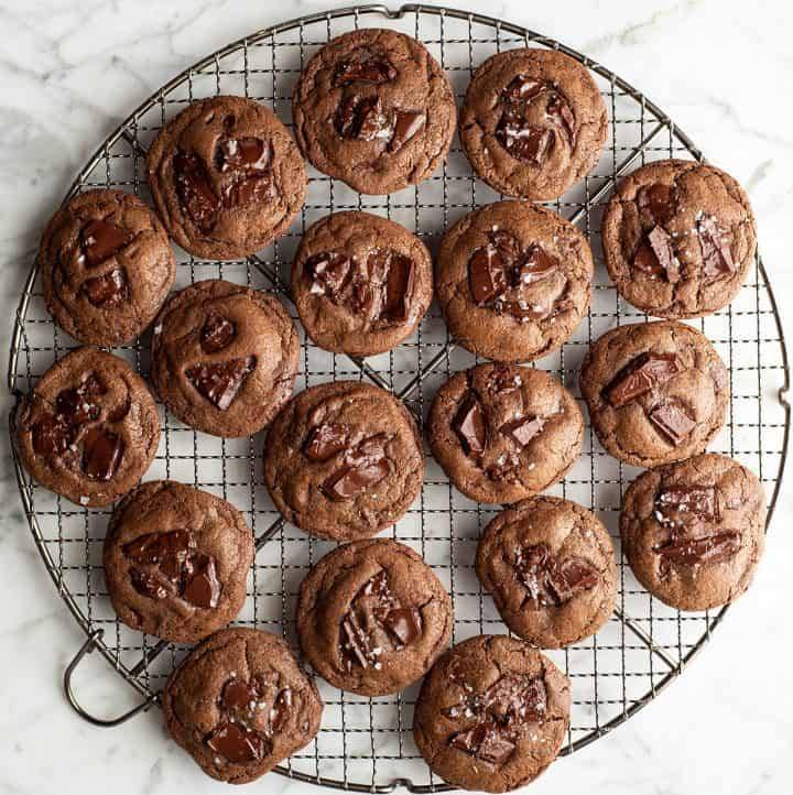 overhead view of 18 double chocolate cookies on a cooling rack