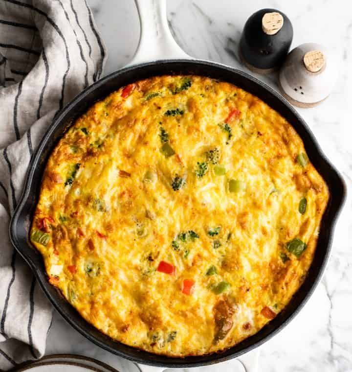 overhead view of a vegetable frittata in a cast iron skillet