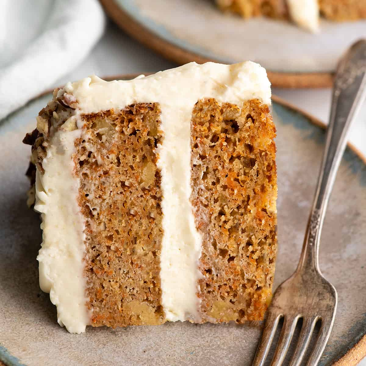 slice of healthy pineapple carrot cake on a plate with a fork