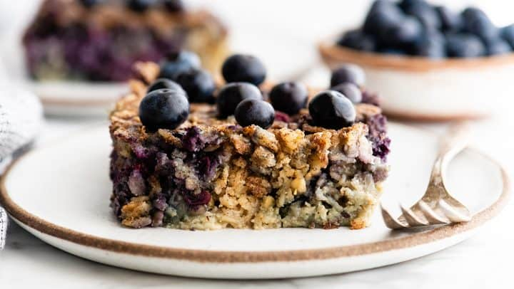 front view of a piece of Blueberry Baked Oatmeal on a plate with a fork