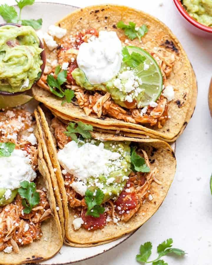 overhead view of three crockpot chicken tacos