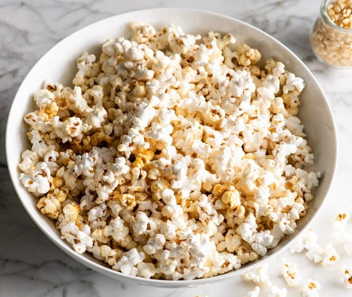 front view of a large white bowl of kettle corn