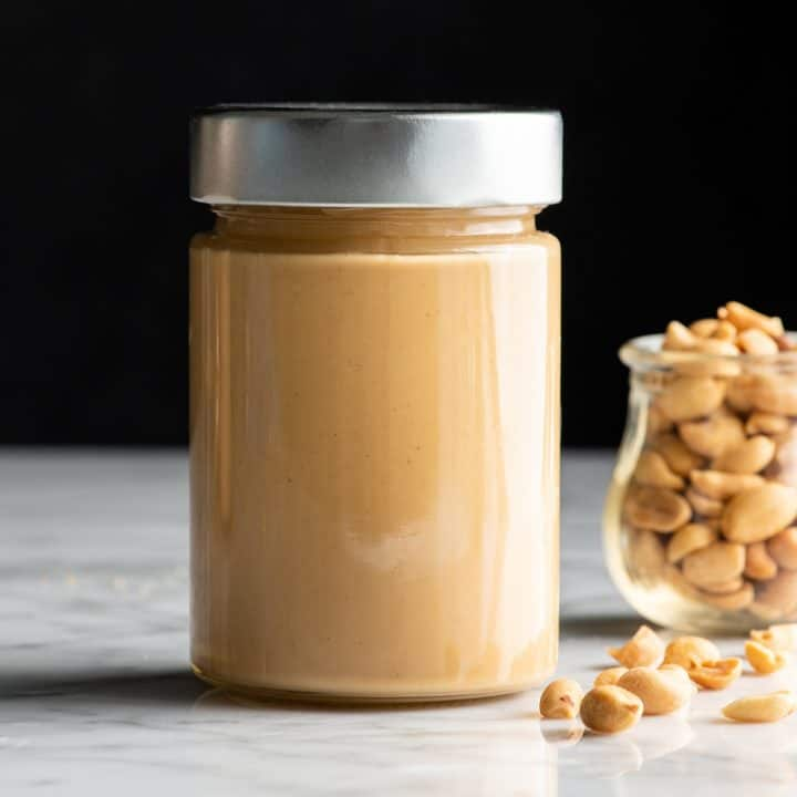 front view of a glass jar of homemade peanut butter