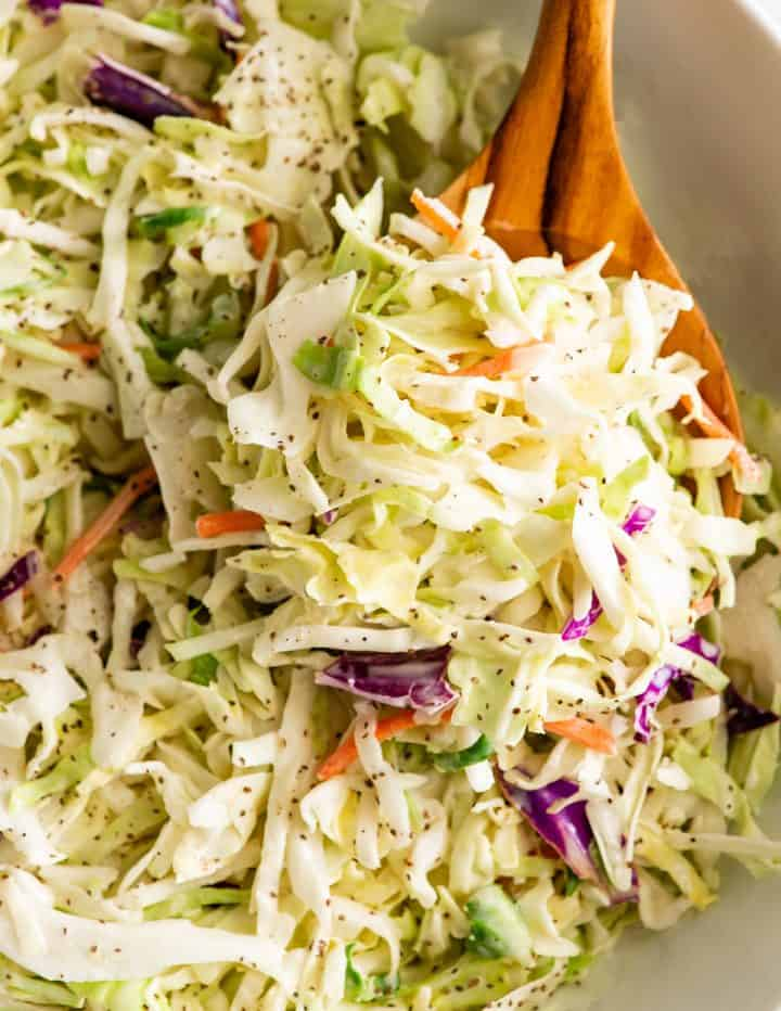up close photo of a spoon of coleslaw