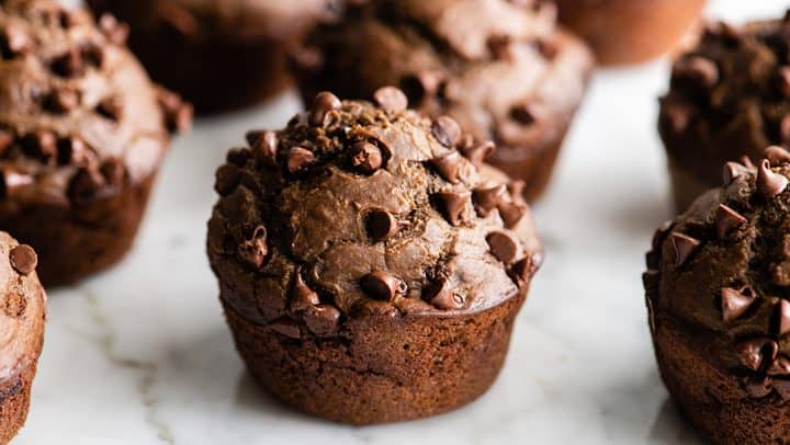 front view of 6 Healthy Chocolate Zucchini Muffins with chocolate chips