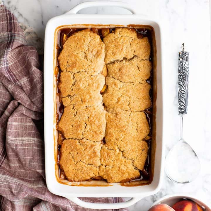 peach cobbler in a baking dish after being baked