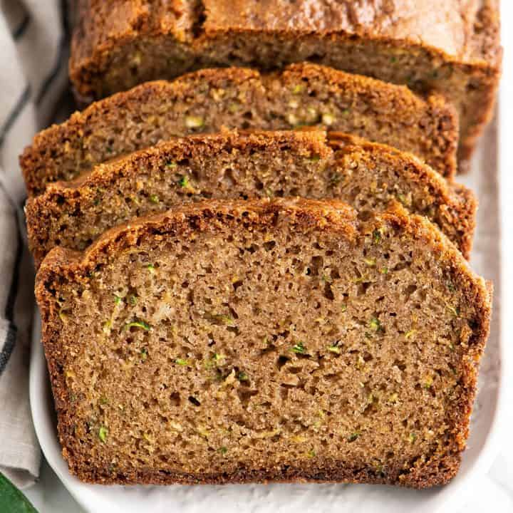 Front view of 3 slices of zucchini bread