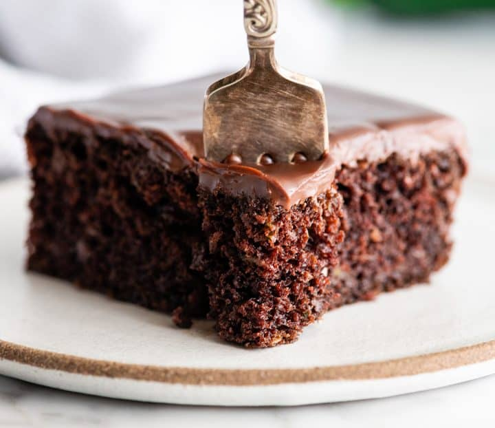 front view of a fork taking a bite of chocolate zucchini cake