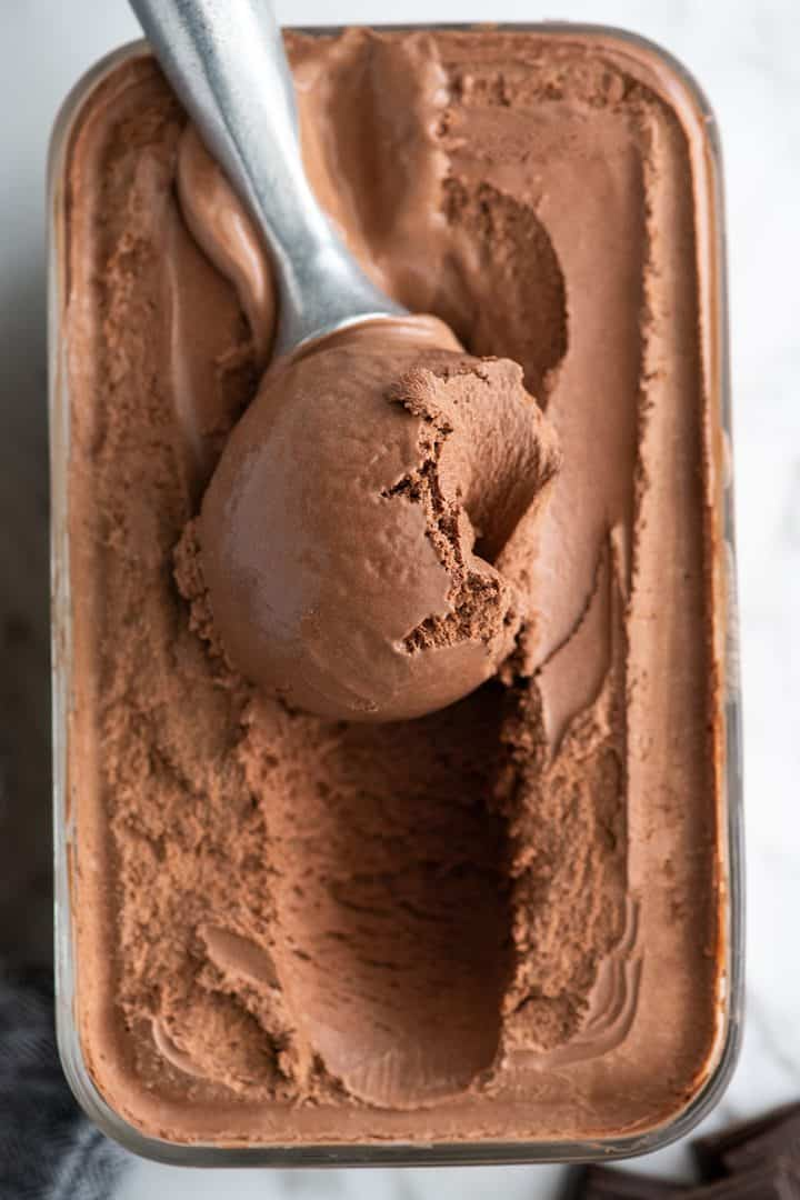 Overhead photo showing a scoop of chocolate ice cream