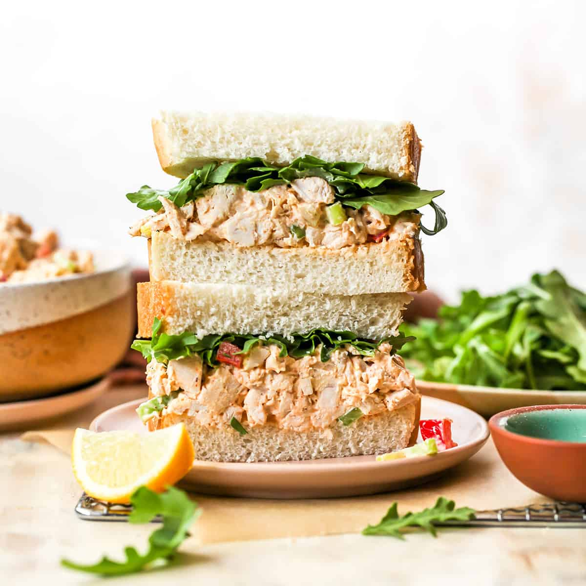 front view of two halves of a chicken salad sandwich stacked