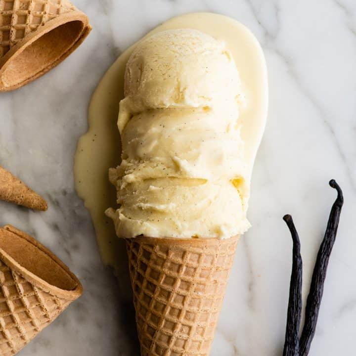 3 scoops of vanilla ice cream on a sugar cone