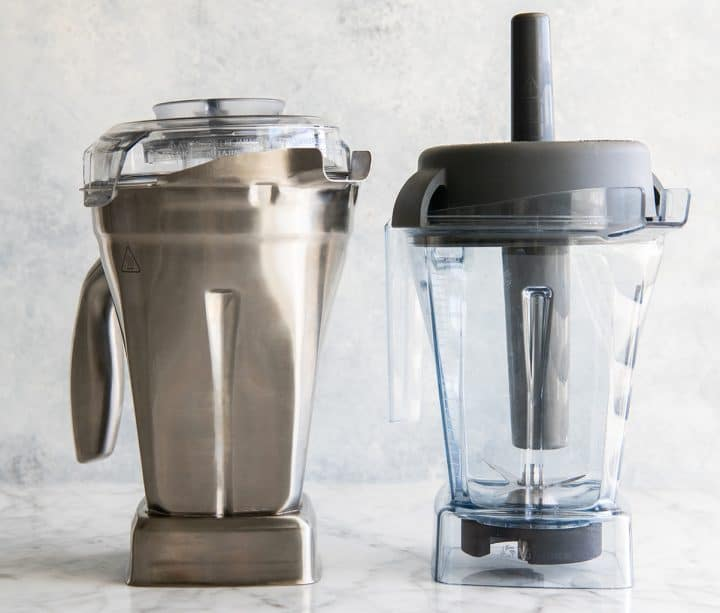 Vitamix stainless steel container next to 48 oz Vitamix container