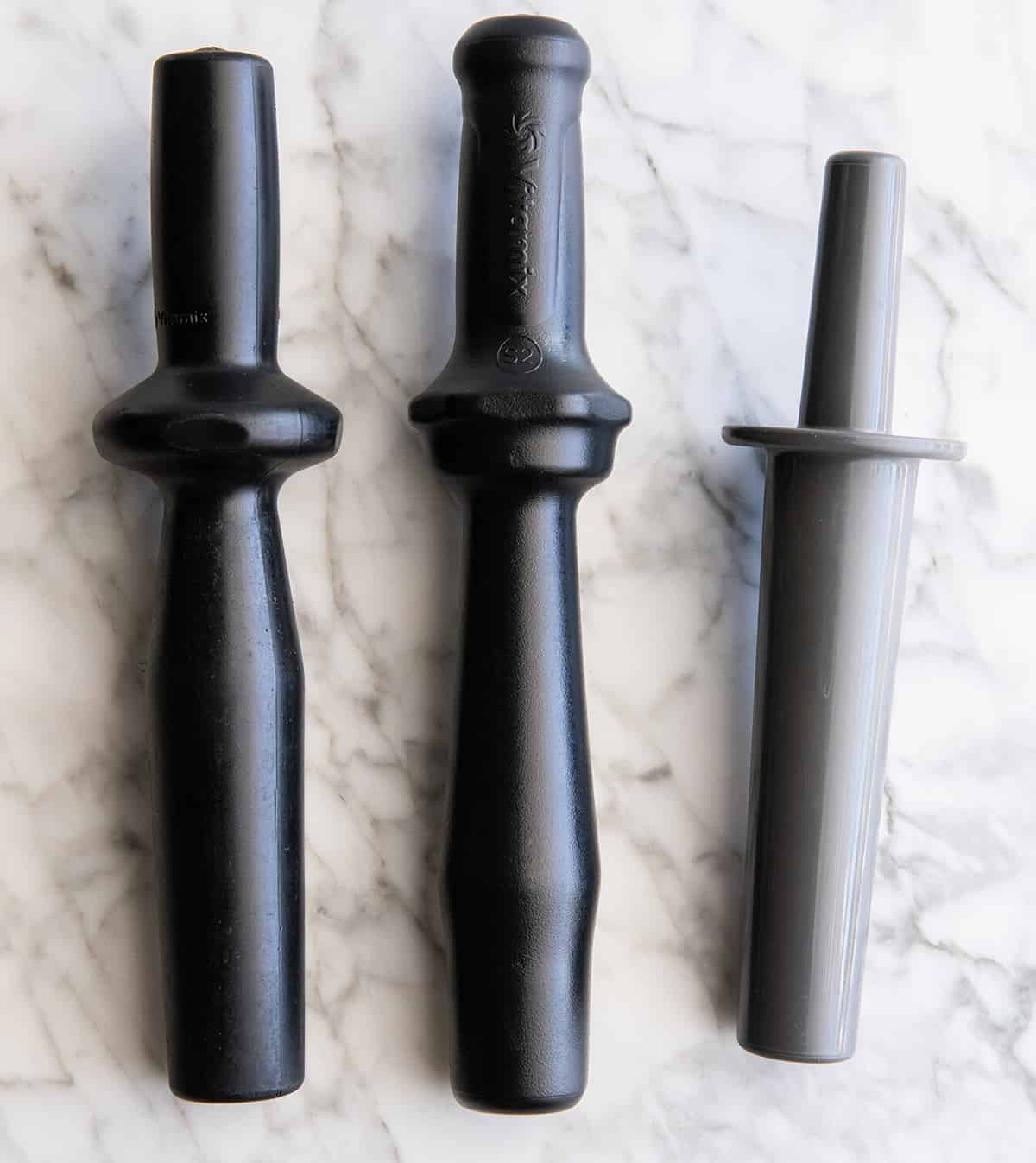 overhead view of 3 different Vitamix tampers