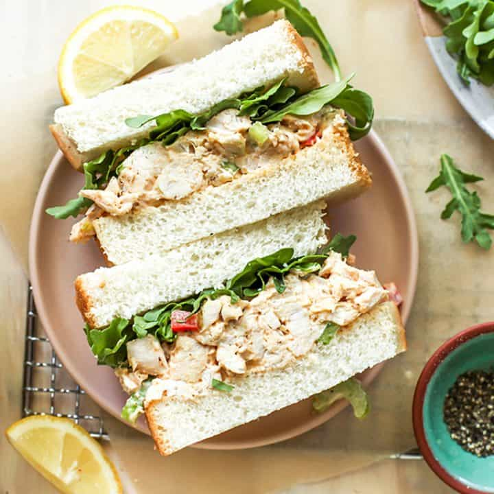 overhead view of two halves of a chicken salad sandwich on a plate