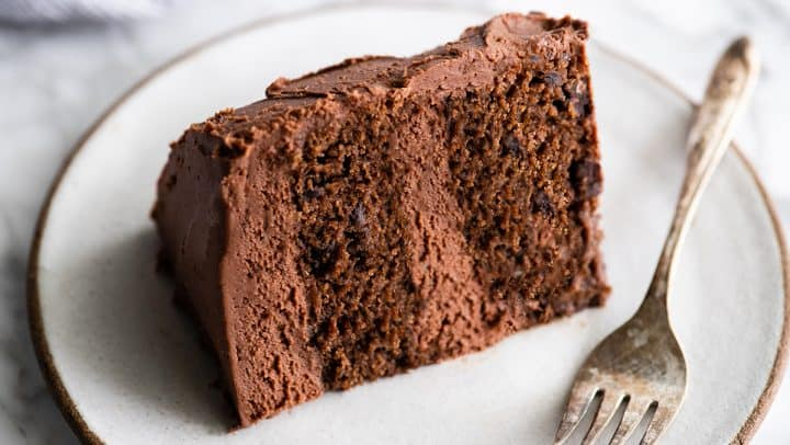 front view of a slice of chocolate cake on a plate