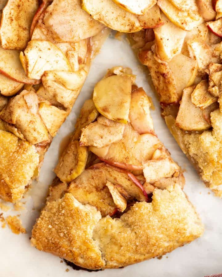 overhead view of a slice of apple galette cut into a triangle